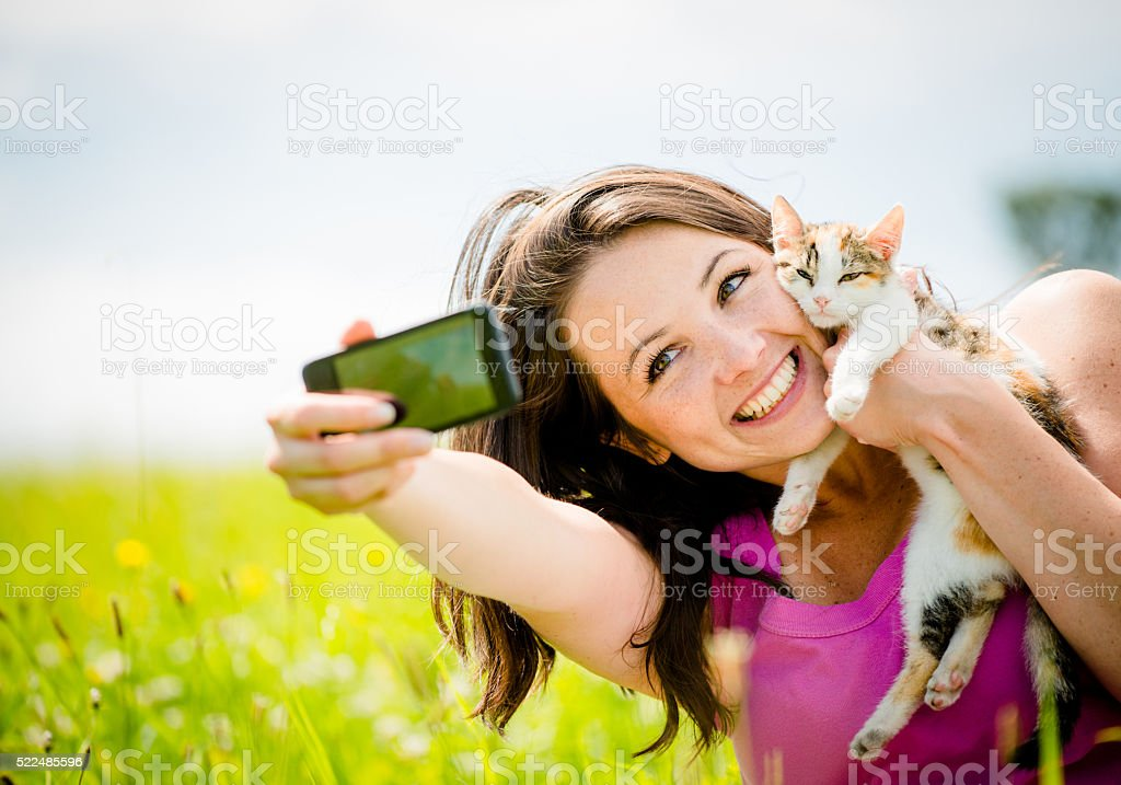 Selfie woman and cat stock photo
