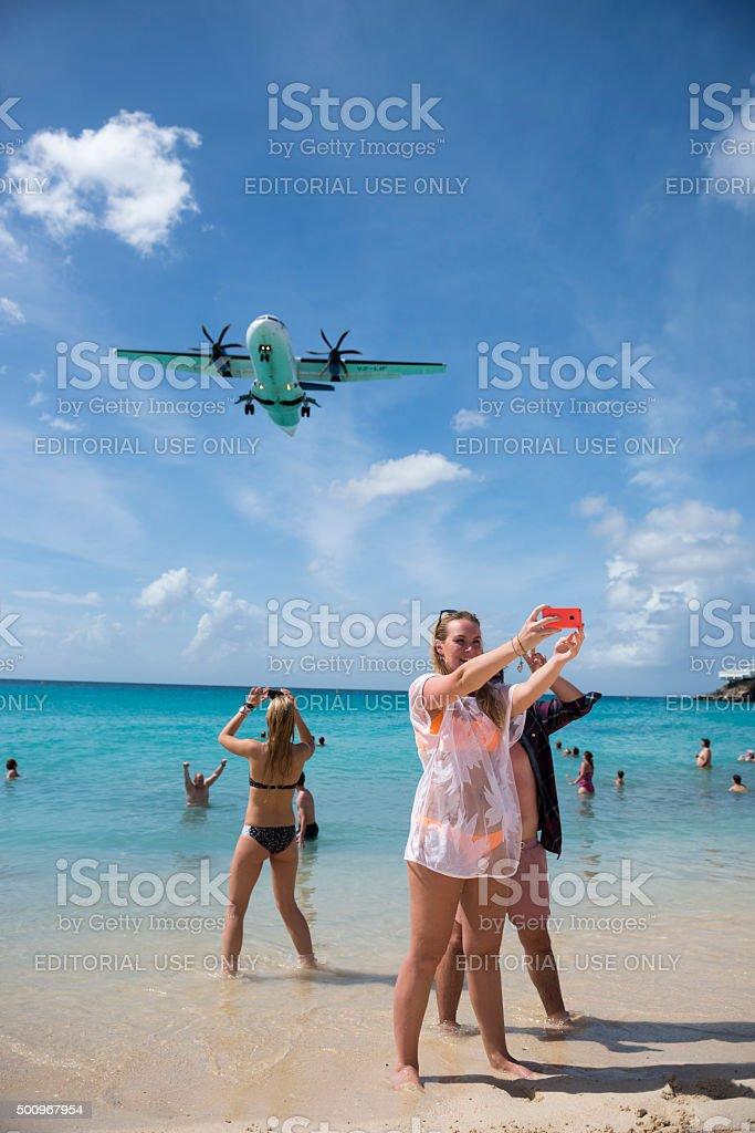 Selfies and aircraft at Maho Beach, St. Maarten stock photo