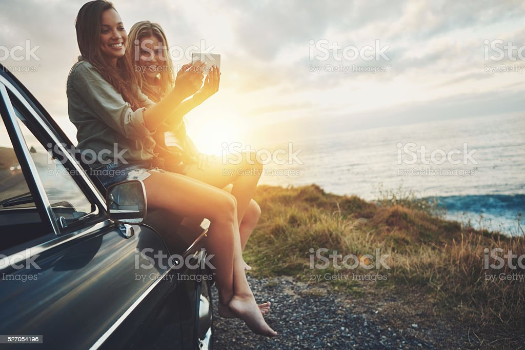 Selfies with the sunrise in the background stock photo