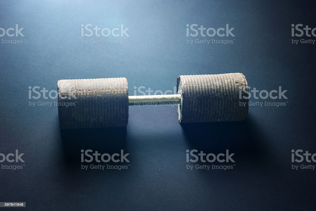 selfmade rusty dumbbell on black background stock photo