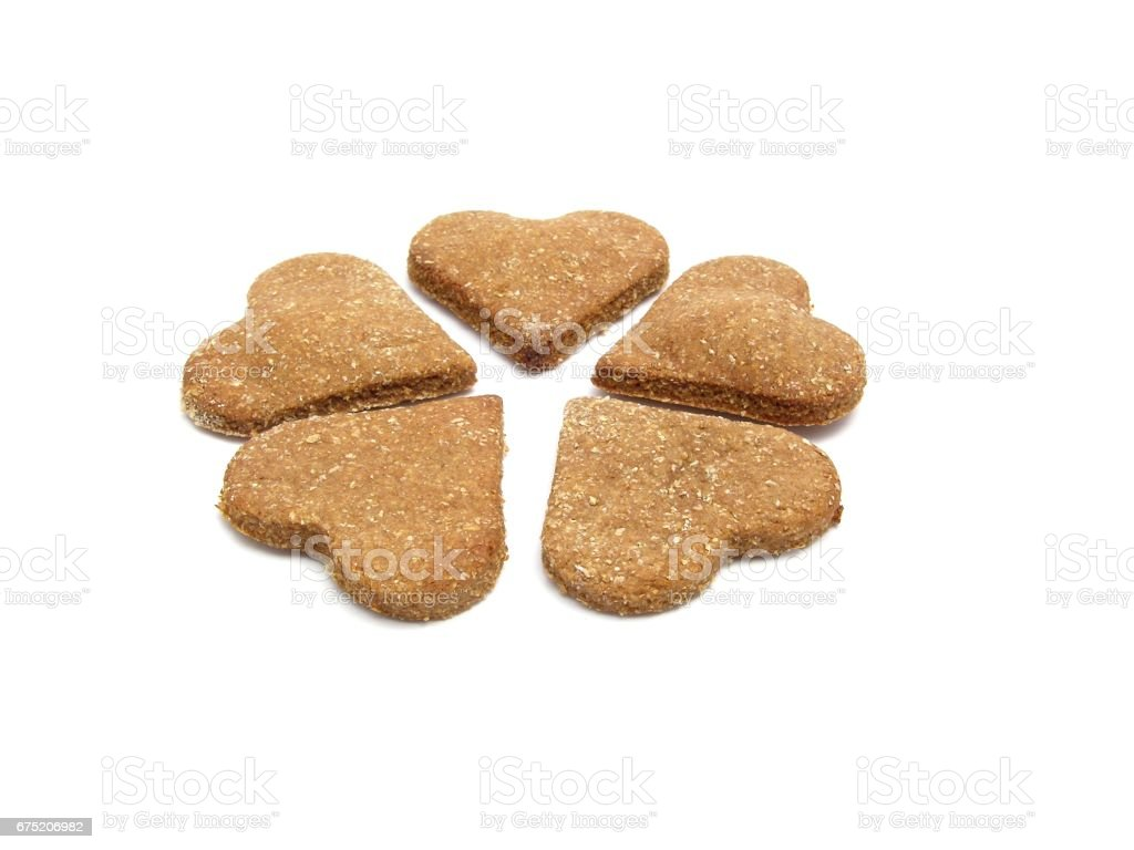 Selfmade wholemeal-hearts for dogs stock photo