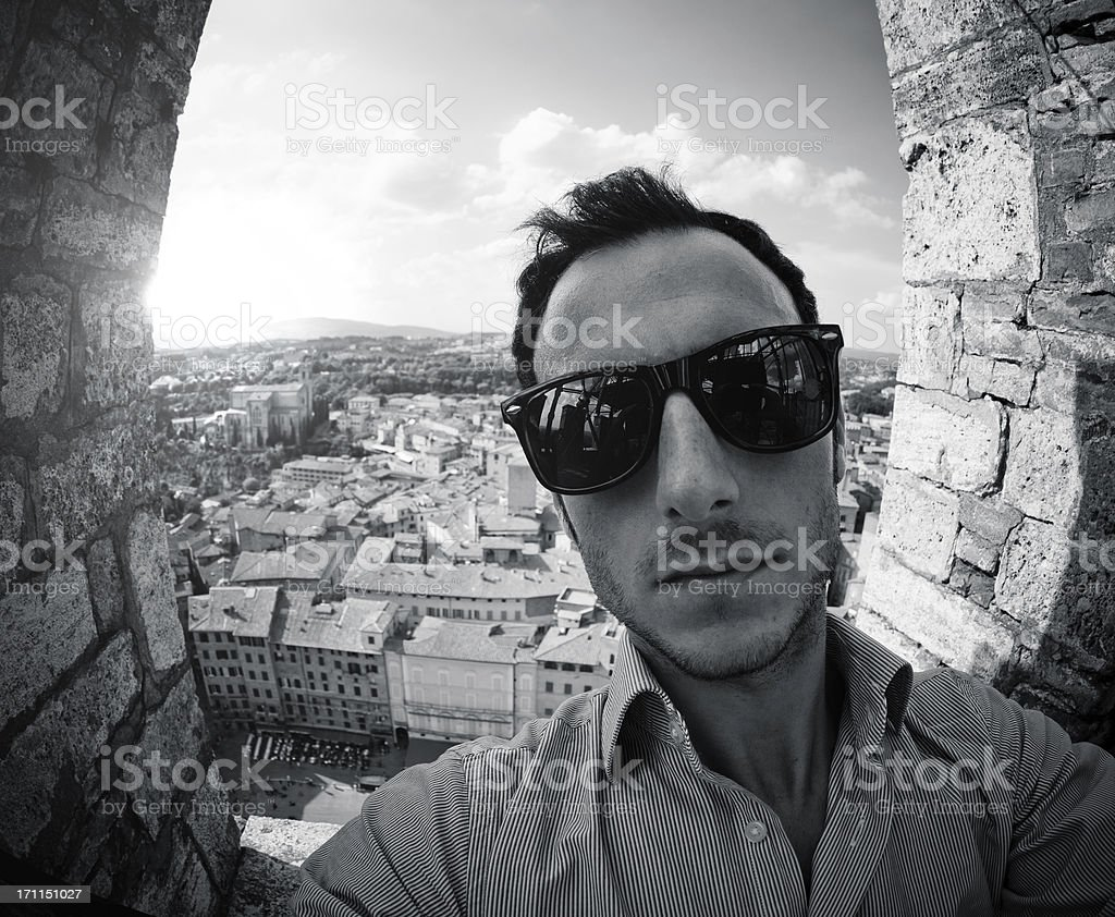 Selfportrait from the Mangia Tower in Siena at dusk royalty-free stock photo