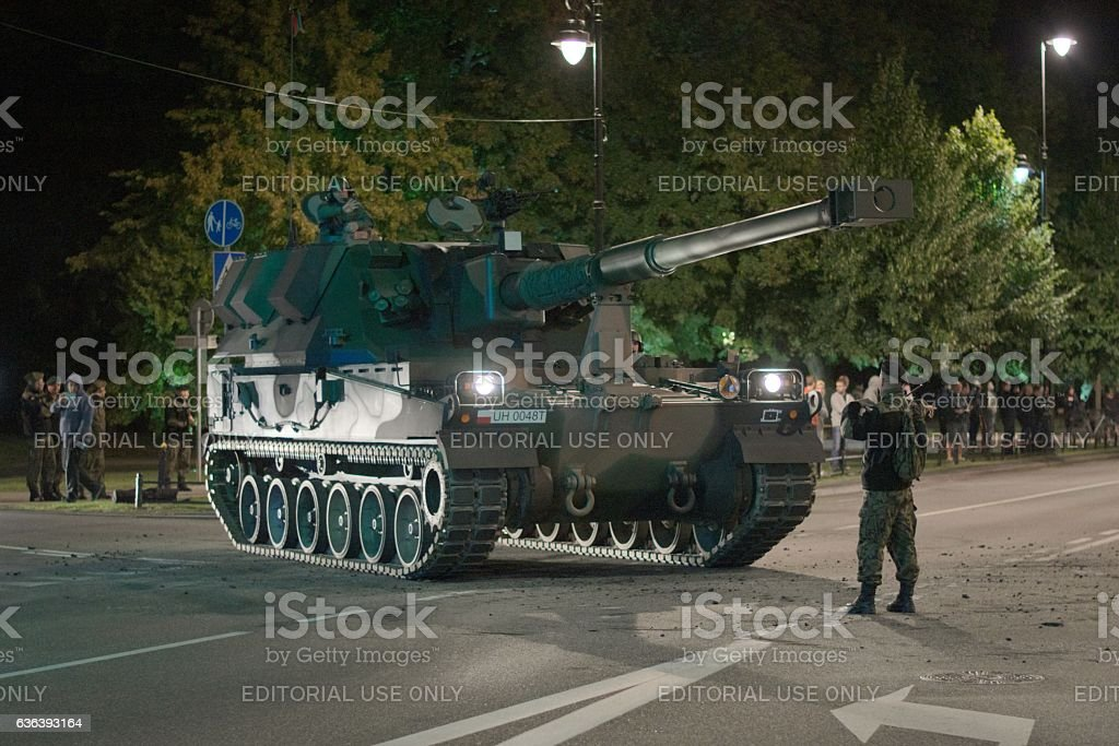 Self-propelled howitzer Krab on the street at night stock photo