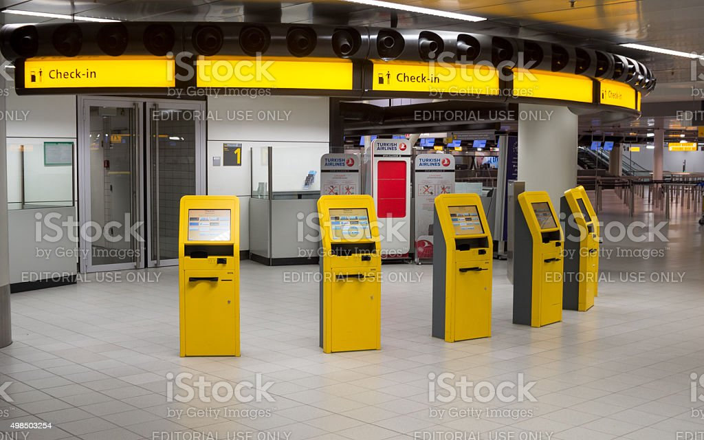 Self-service check-in machines in modern airport stock photo