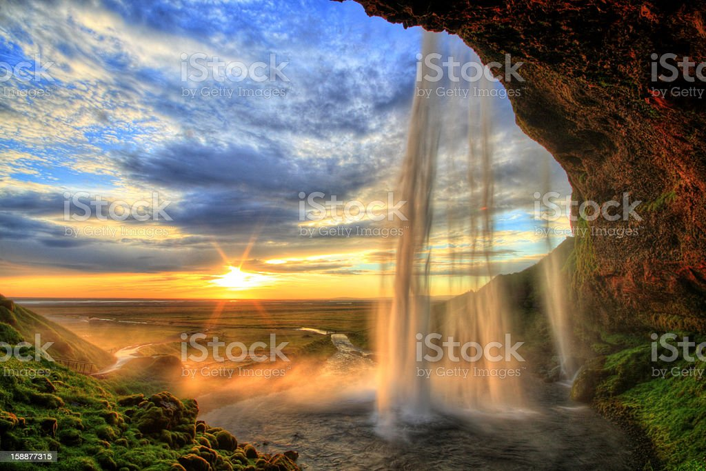 Seljalandfoss waterfall at sunset in HDR, Iceland stock photo