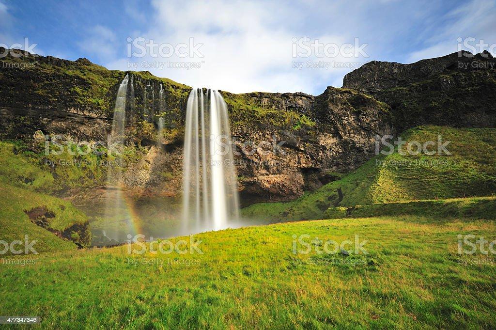 Seljalandsfoss waterfall and rainbow stock photo