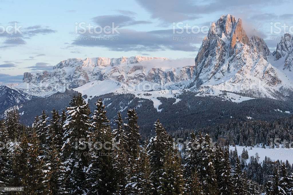 Sella massif and Sasslong around sunset in Winter stock photo