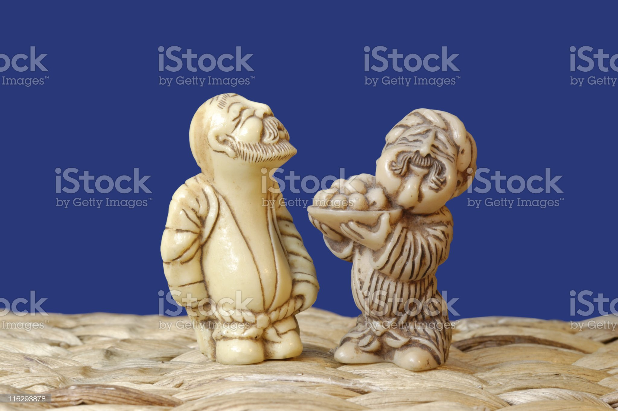 seller and buyer; two figurines isolated on blue royalty-free stock photo