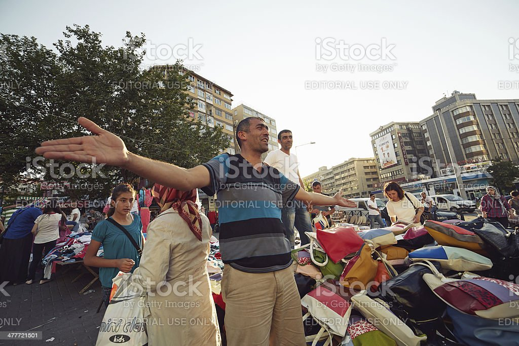 Seller at street market stock photo