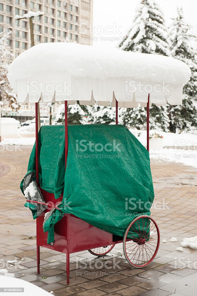 seller cart under snow at the street stock photo