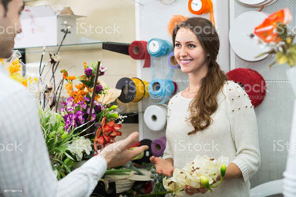 seller helping to pick flowers stock photo