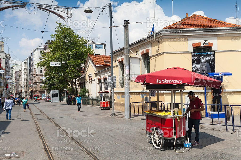 Seller near red cart with boiled corn, Istanbul stock photo