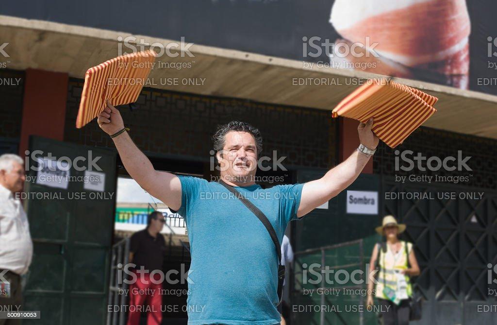 Seller of bullfighting seat cushion stock photo