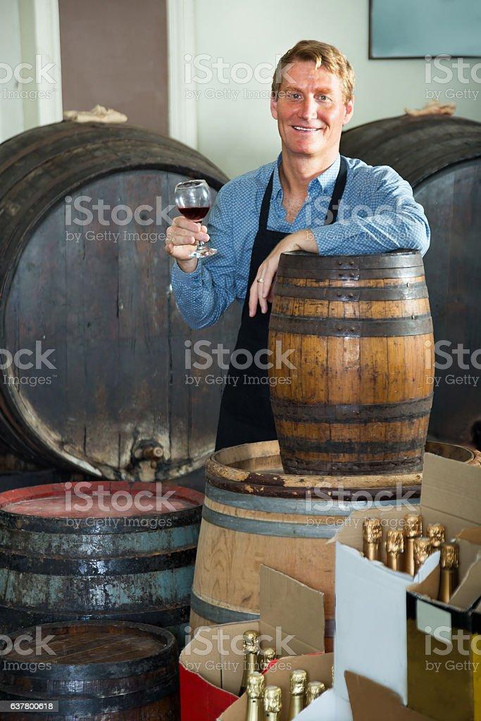 Seller promoting to taste wine stock photo