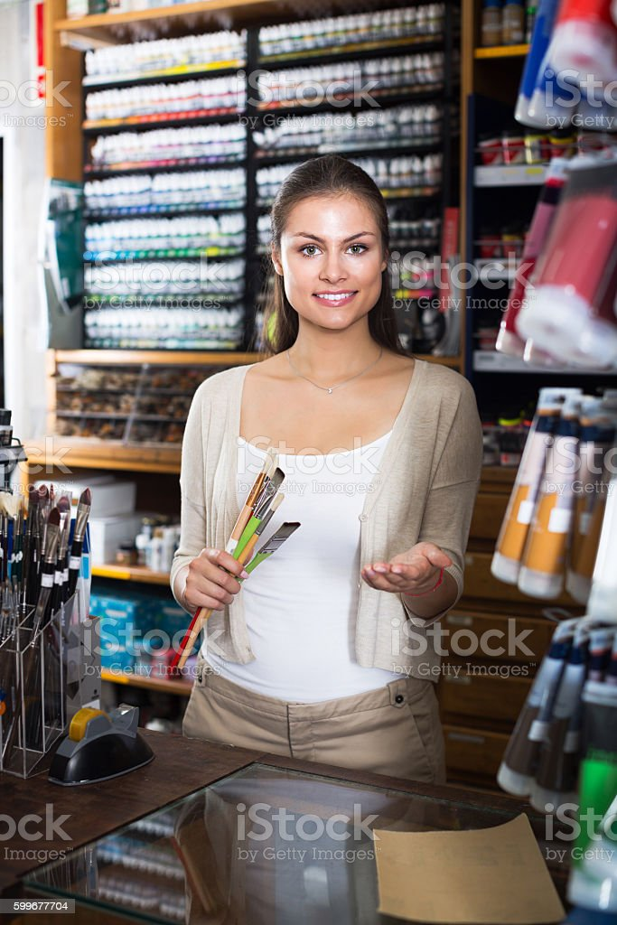 Seller to help at cash desk stock photo