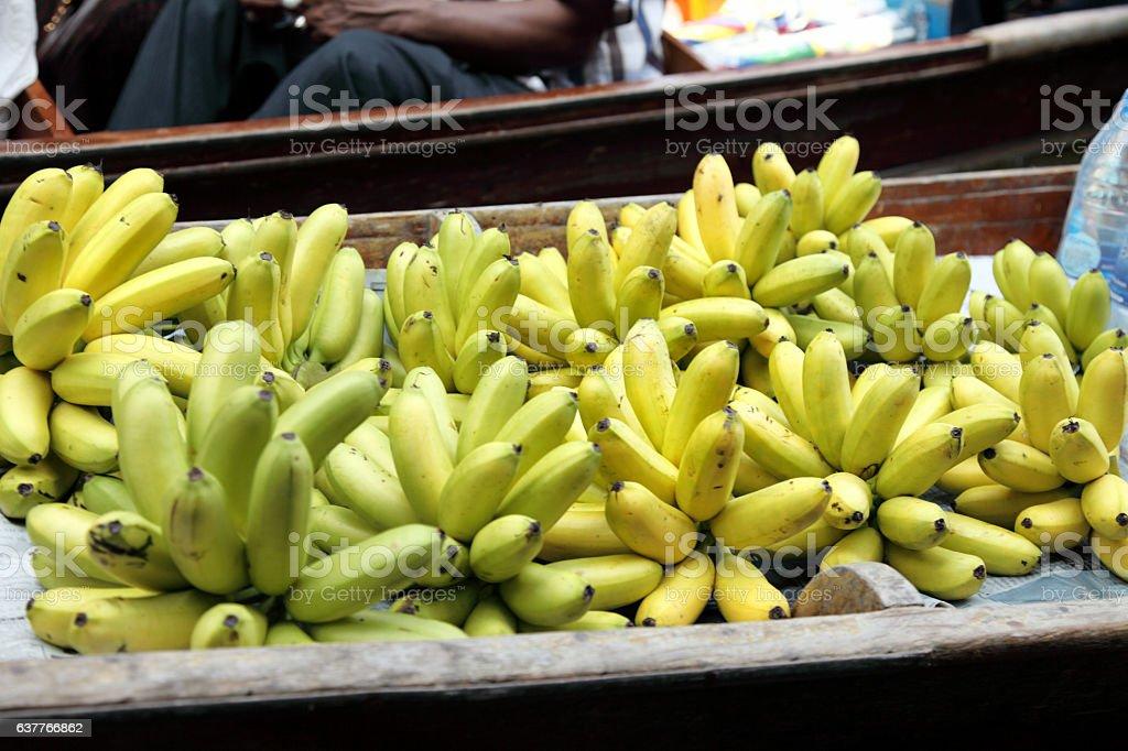 Selling bananas on the Damnoen Saduak floating Market-Thailand stock photo
