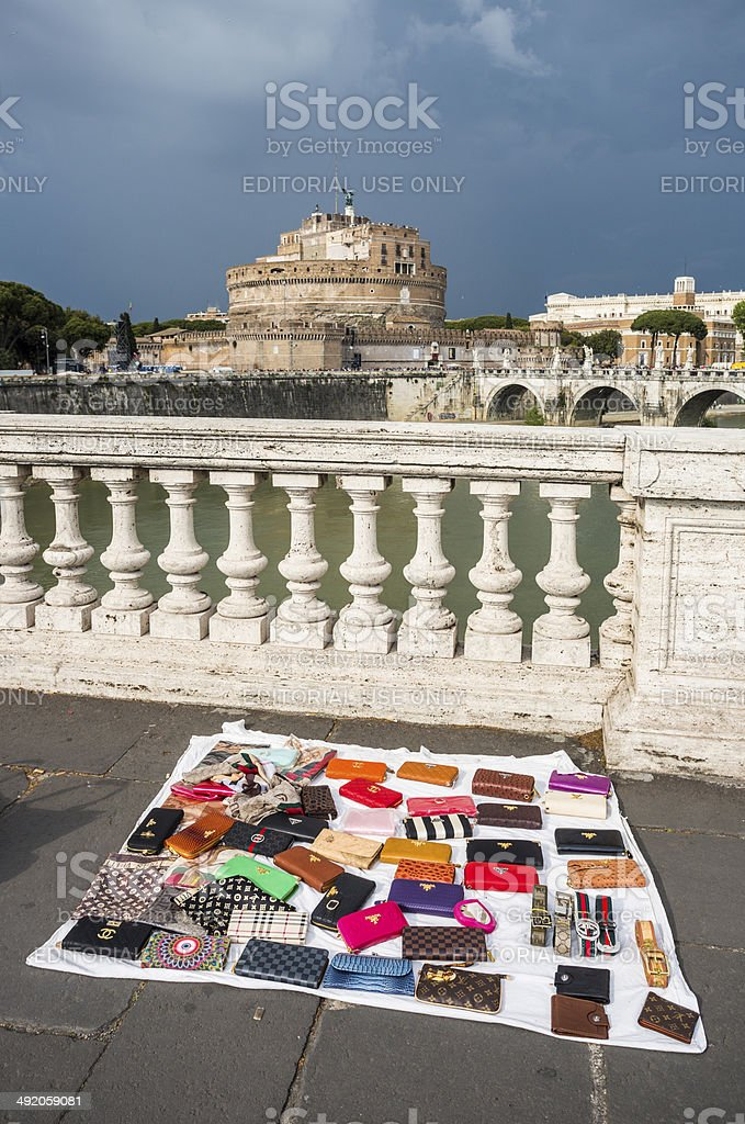 Selling fake bags on the street, Rome Italy royalty-free stock photo