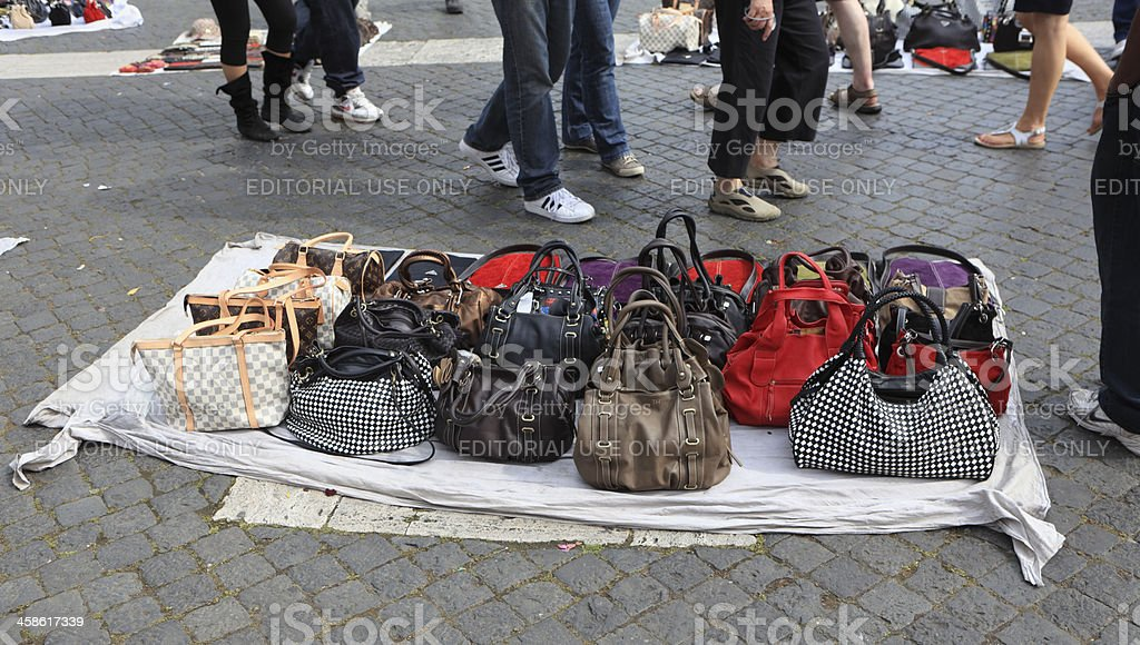 Selling fake designer bags on the street in Rome, Italy stock photo