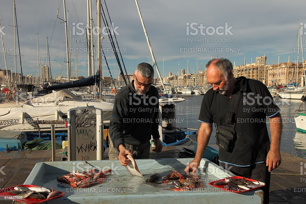 Selling fish at the market, Old Port of Marseille stock photo