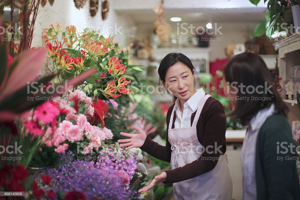 Selling flowers at  Flower shop stock photo