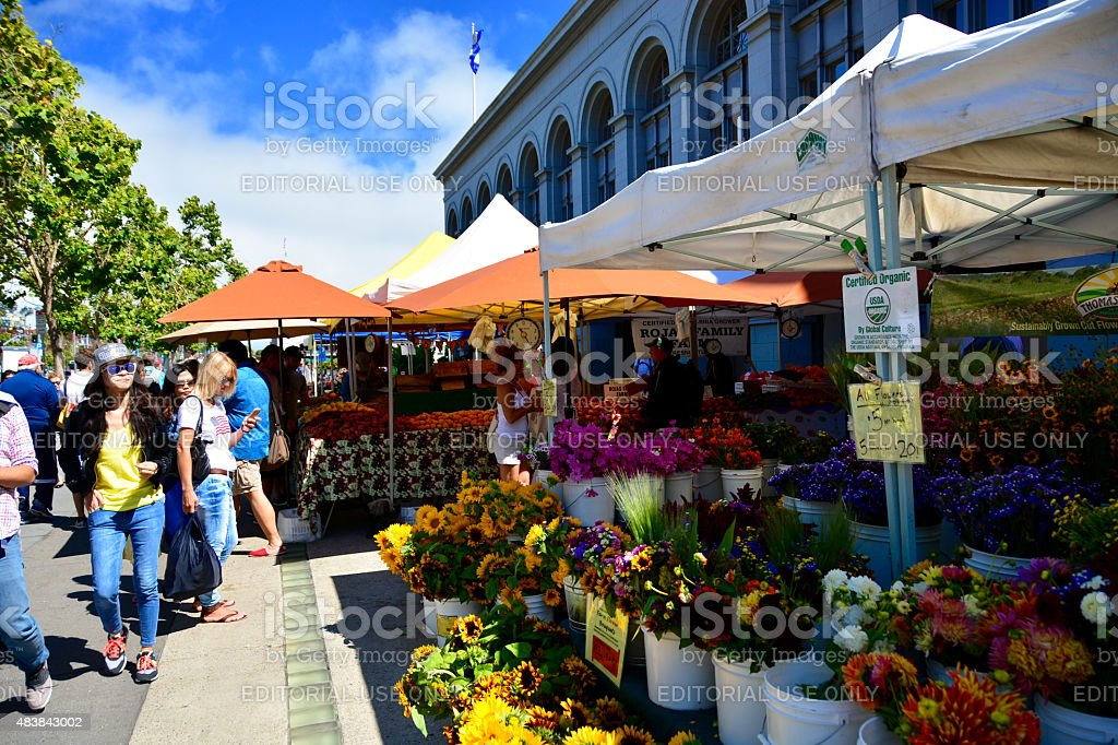 Selling flowers at organic farmers market stock photo