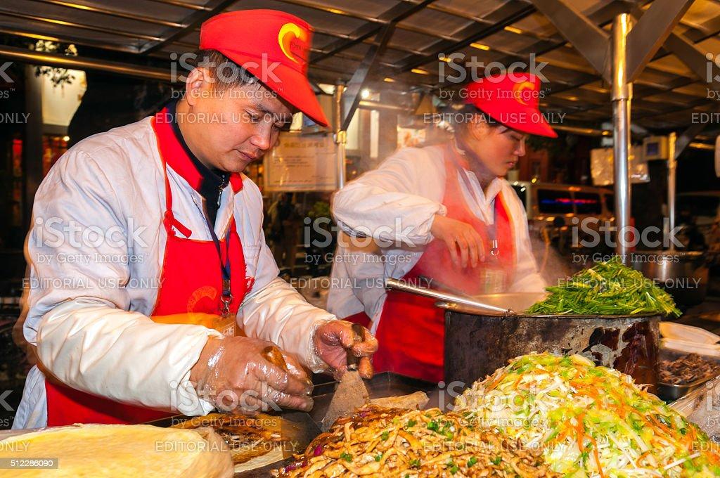 Selling Food at Donghuamen Market Beijing China stock photo
