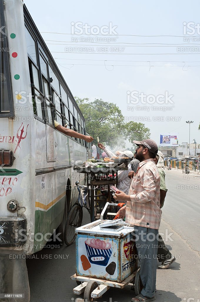 Selling Food to Bus Passengers royalty-free stock photo