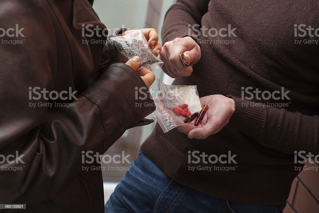 Selling heroine, tabs and hashish stock photo