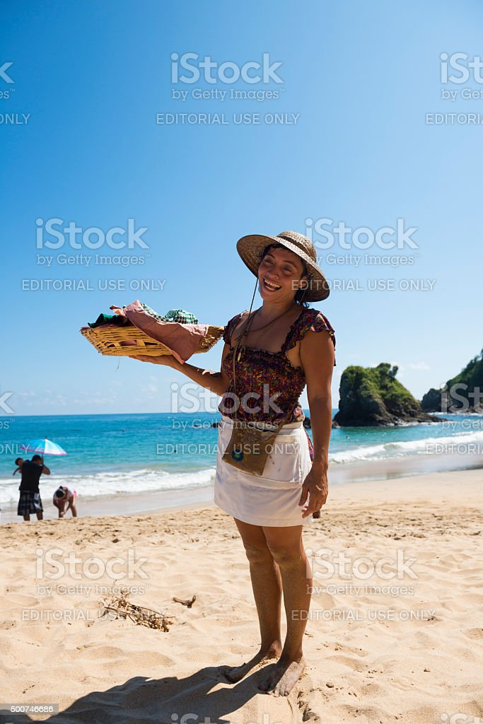 Selling homemade tamales on beach in Mexico stock photo