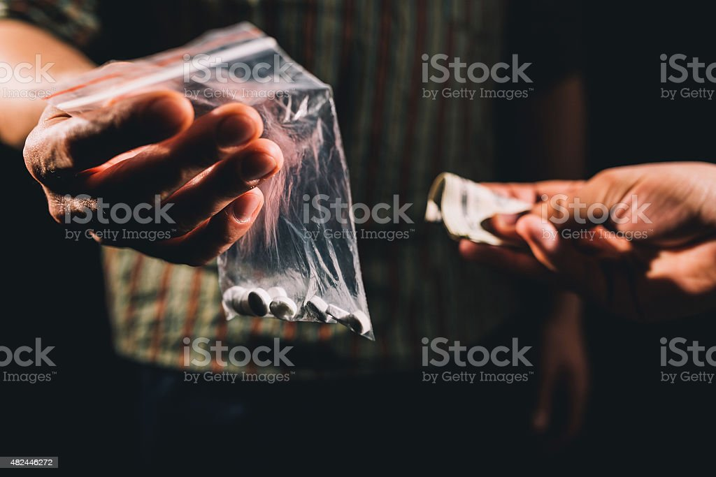 Selling illegal pills stock photo