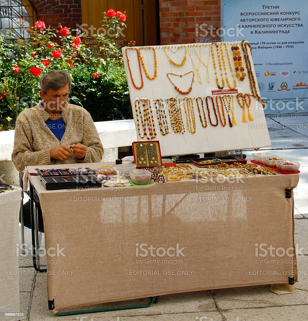 Selling jewelry made of amber stock photo