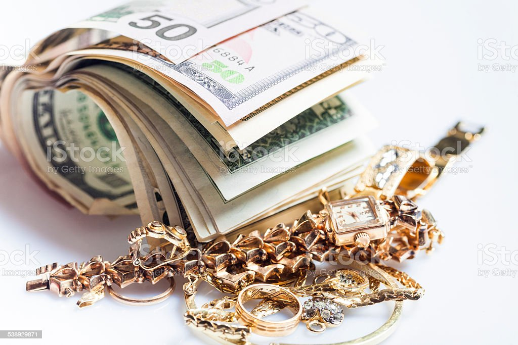 Selling jewels for cash stock photo