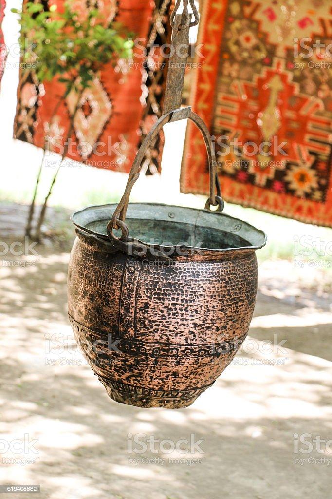 Selling old metal  cookware in bazaar stock photo
