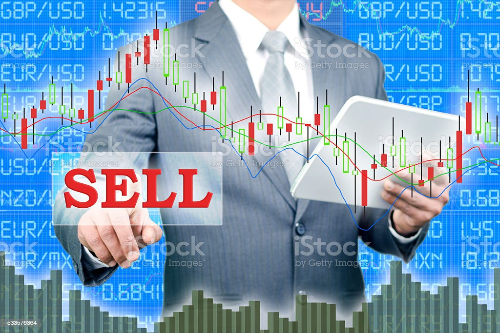 Selling on foreign exchange market stock photo