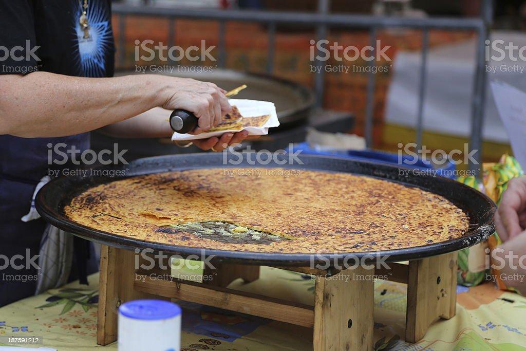 selling socca (farinata) stock photo