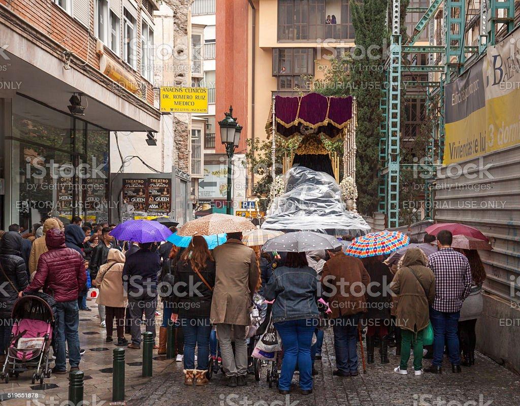 Semana Santa in rainy Malaga: following a procession stock photo