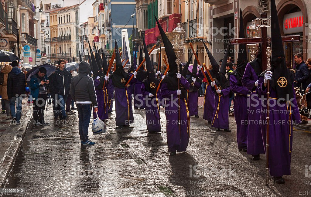 Semana Santa in rainy Malaga: procession of Crucifixión brotherhood stock photo