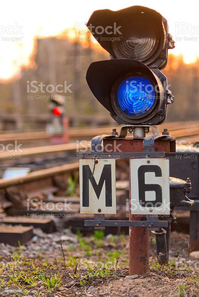 semaphore on railway lit blue light stock photo