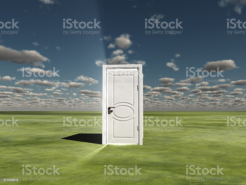 Semi Closed door in landscape emits light stock photo