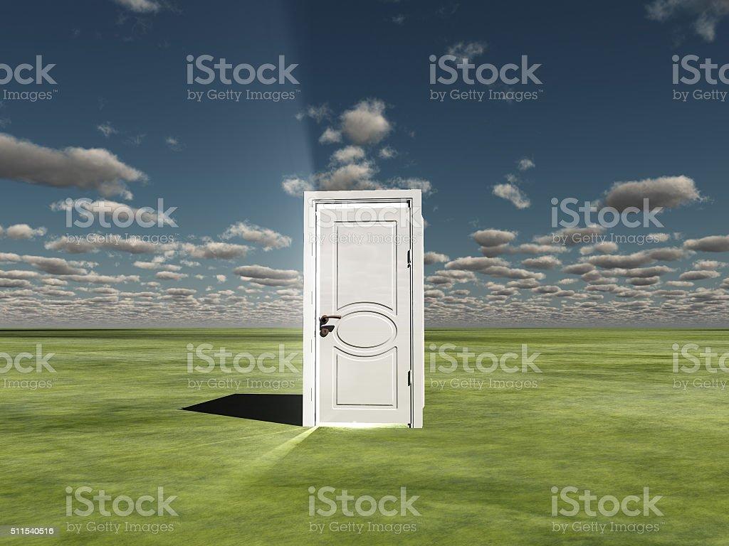 Semi Closed door in landscape emits light stock photo