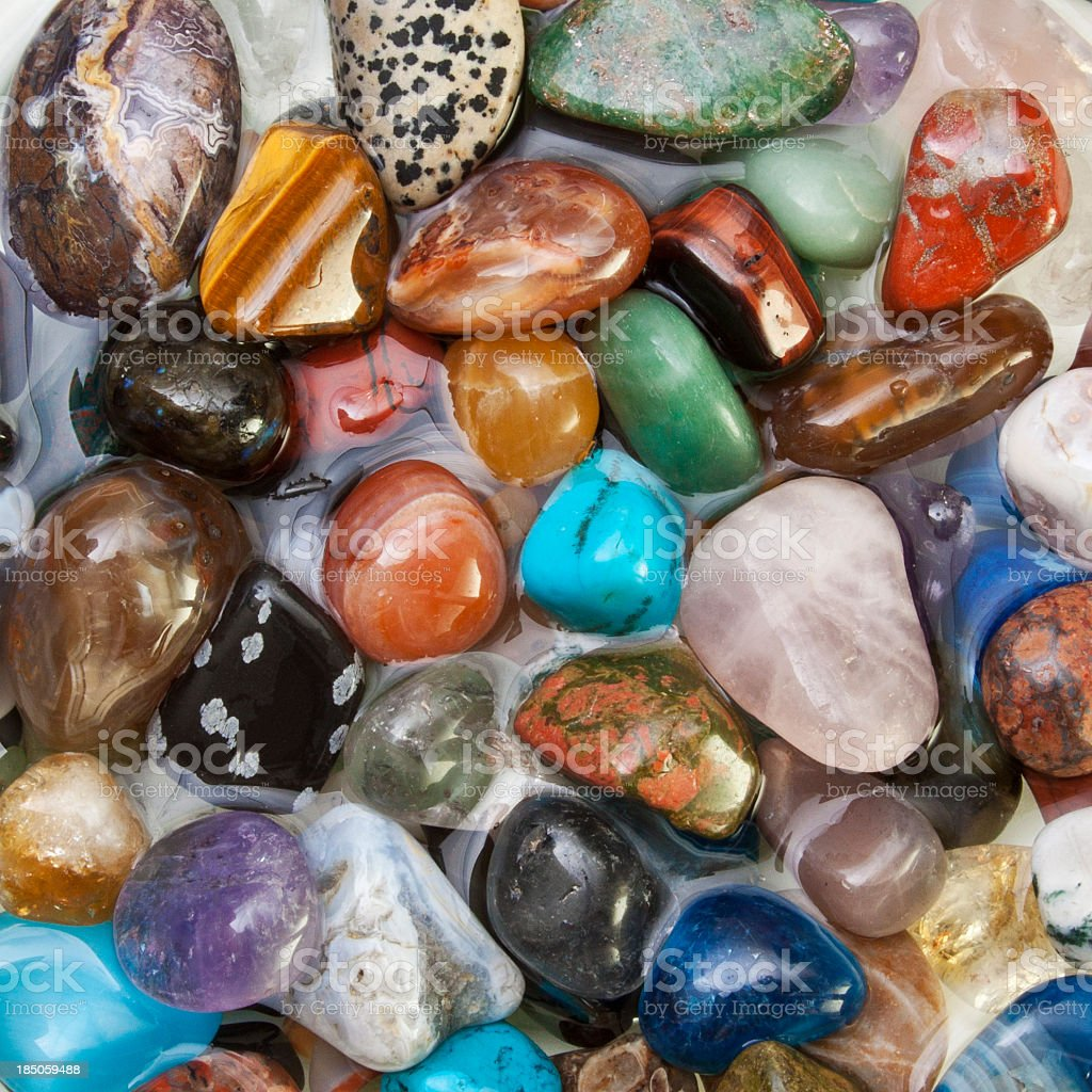 Semi precious gems glued together stock photo