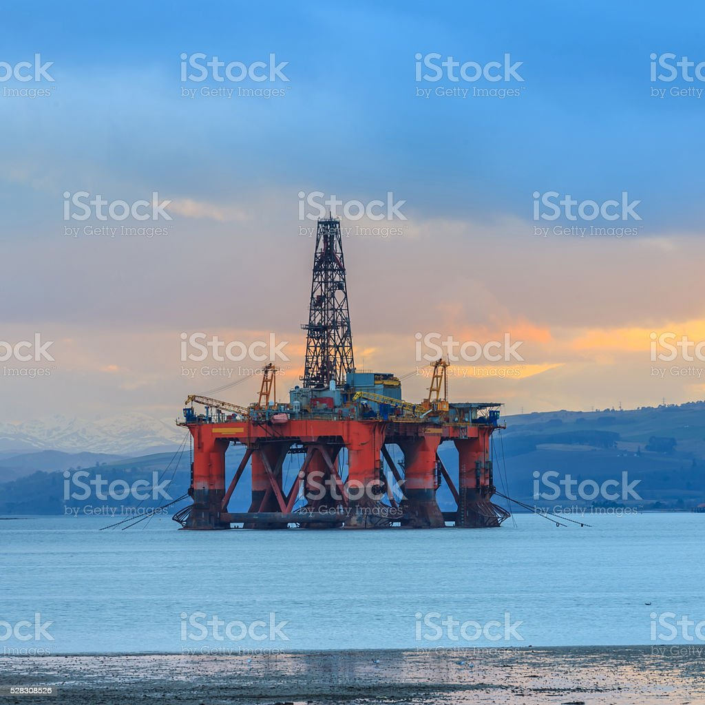 Semi Submersible Oil Rig at Cromarty Firth during Sunset Time stock photo