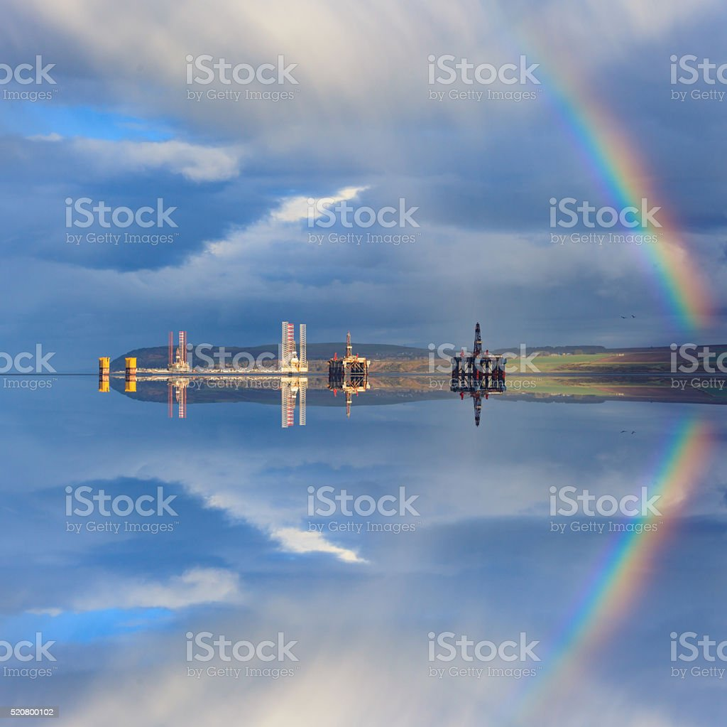 Semi Submersible Oil Rigs and Rainbow with Reflection stock photo