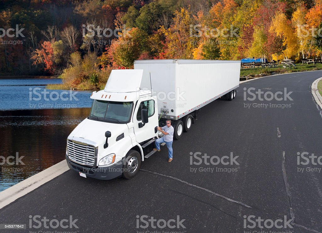 Semi tractor and trailer in the fall colors stock photo