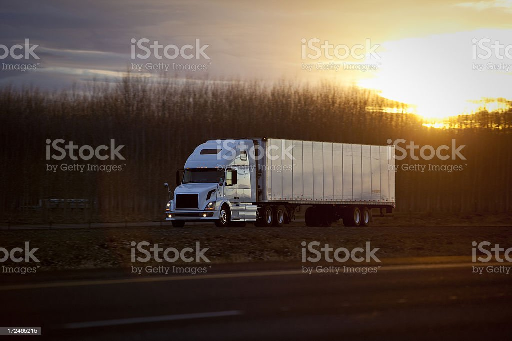 Semi tractor trailer on highway at sunset. royalty-free stock photo