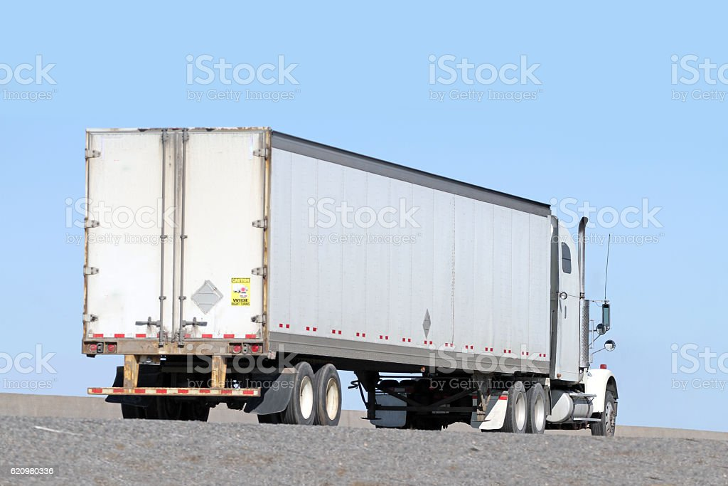 Semi Tractor Trailer Truck Hauling Freight On Interstate Highway stock photo