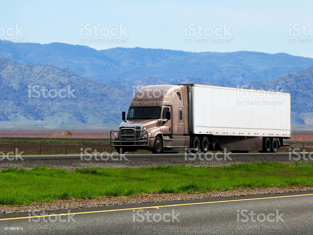 Semi Tractor Truck Trailer on Interstate Highway Freight Transportation Industry stock photo