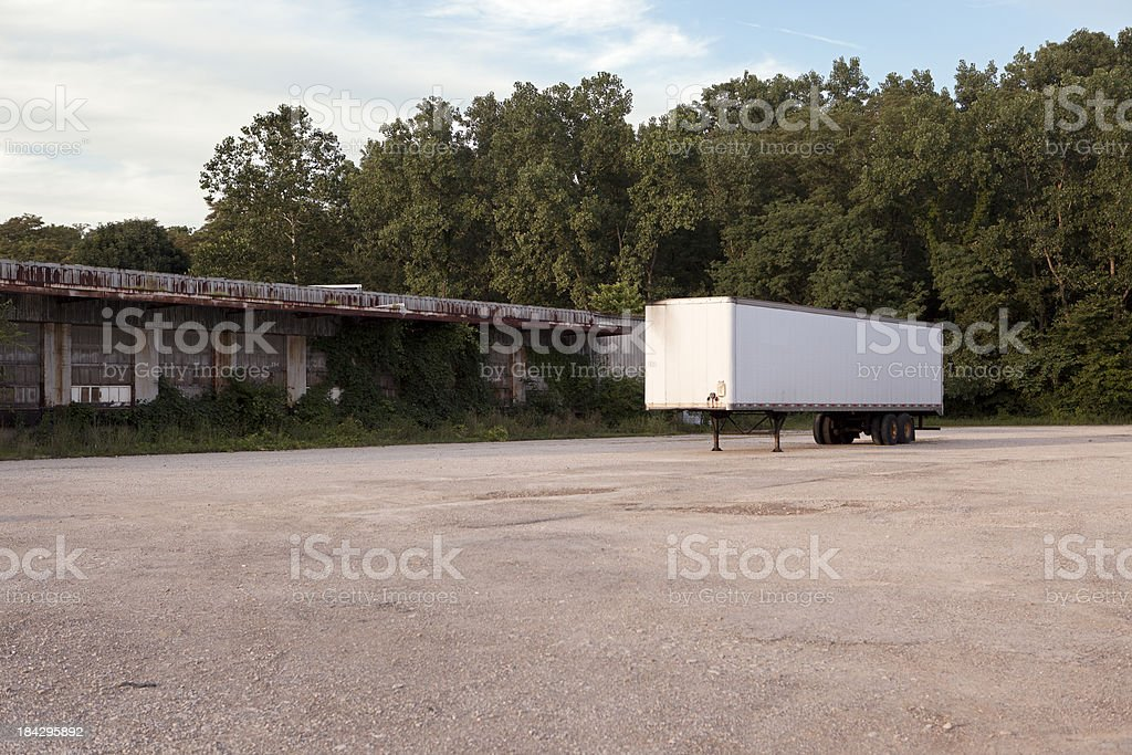 Semi Trailer at Abandoned Factory Warehouse royalty-free stock photo