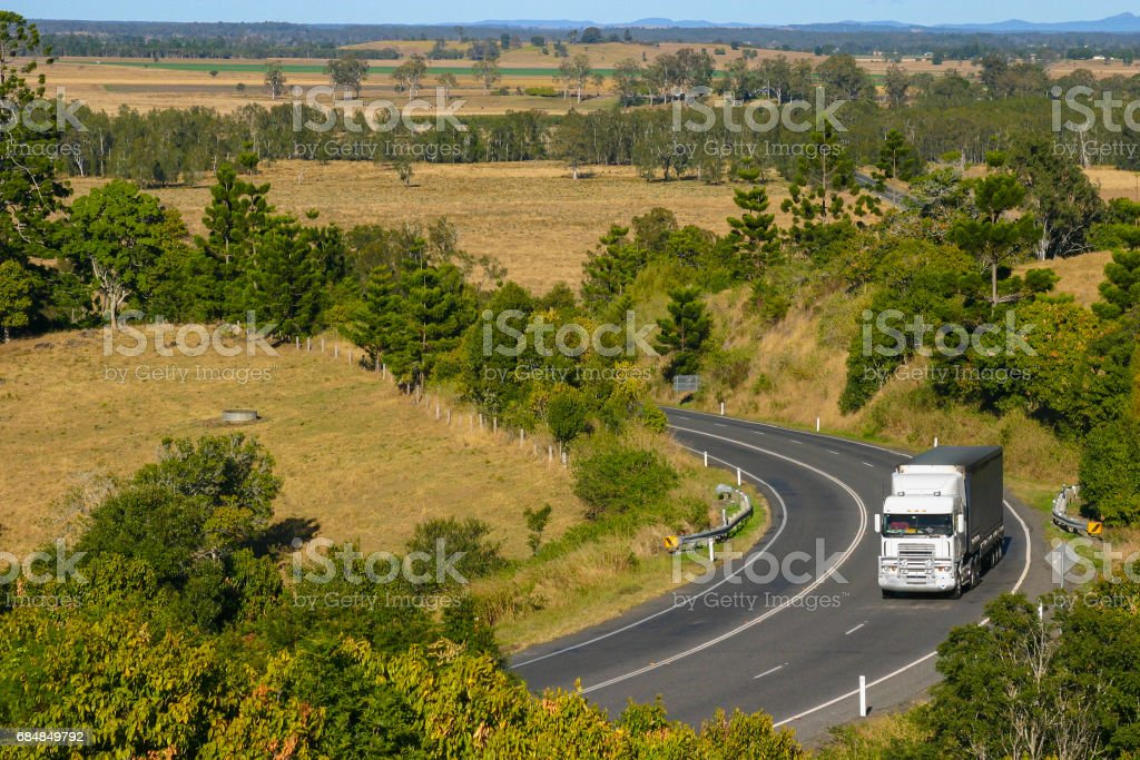 Semi Trailer Truck Delivering on a Rural Country Highway stock photo