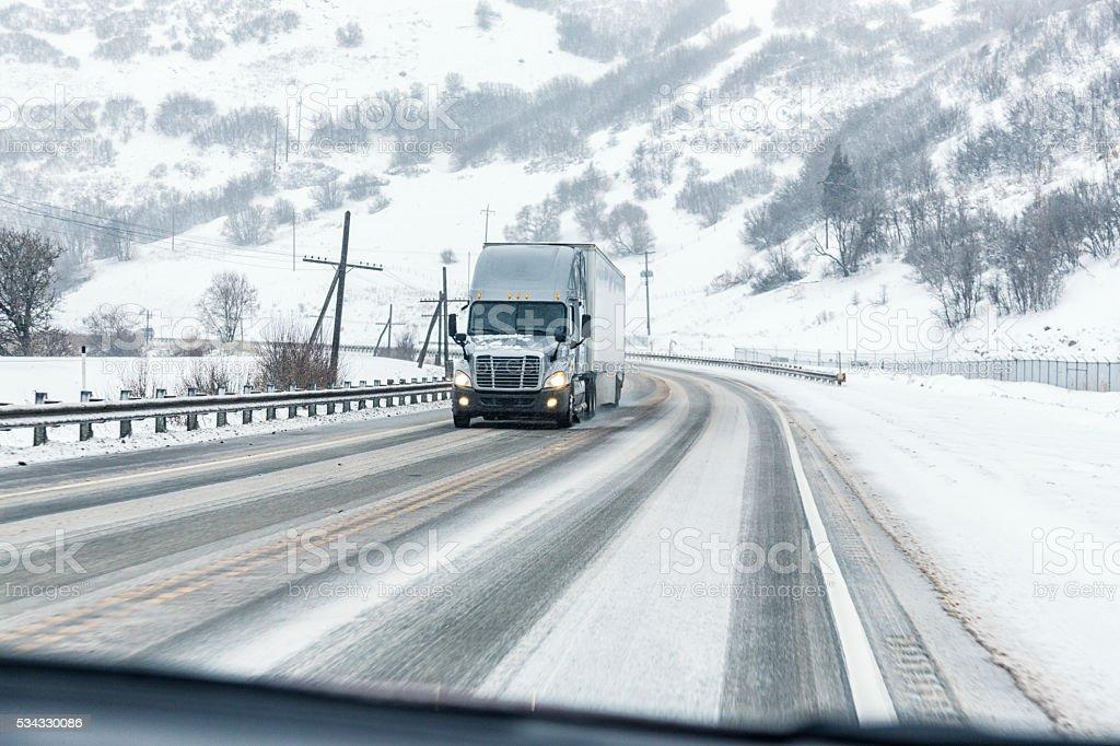 Semi Trailer Truck Passing On Slippery Winter Highway stock photo